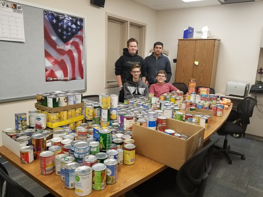 Drake Nicholson, Hunter Henry, Dylan Phillips and Julian Gomez help box up the canned goods and organize the donations.